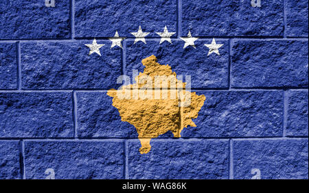 Flag of Kosovo close up painted on a cracked wall - Stock Photo