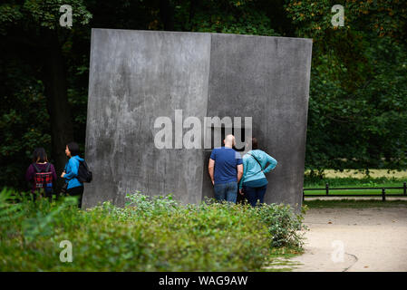 August 16, 2019, Berlin, Germany: Visitors watch a film with a kiss scene through a window at the Monument to homosexuals persecuted under National Socialism. (Credit Image: © Omar Marques/SOPA Images via ZUMA Wire) - Stock Photo