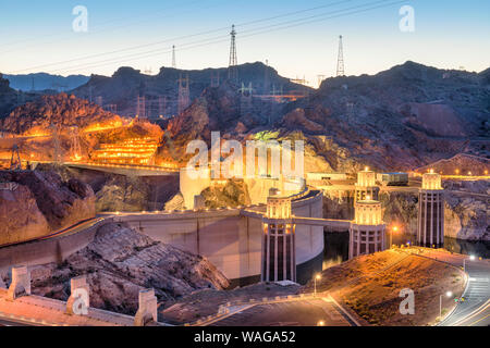 Hooover Dam on the Colorado River straddling Nevada and Arizona at dusk. - Stock Photo