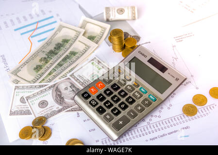 Investors are calculating profits and interest rates using a calculator and have a small amount of money. - Stock Photo