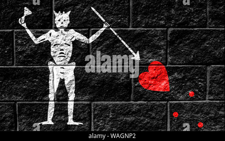 Flag of Blackbeard Pirate close up painted on a cracked wall - Stock Photo