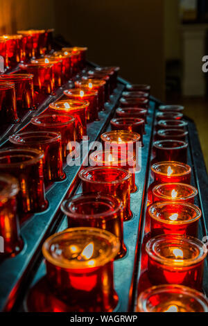 Votive candles or prayer candles in  St Patricks Catholic Church in Newport in County Mayo Ireland - Stock Photo