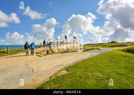 Tourists vist a German World War 2 bunker at Pointe du Hoc, on the coast of Normandy France, the location of the allied D Day invasion in 1944. - Stock Photo