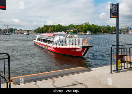 Tourist sightseeing boat cruise to the Abba Museum on the river canal in Stockholm - Stock Photo