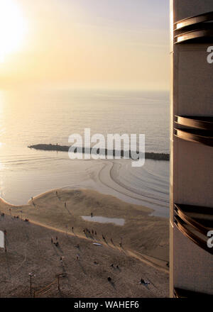 A view of the Tel Aviv beach below from balcony at Herods Hotel at sunset. - Stock Photo