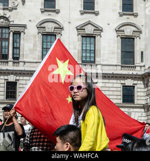 A child attends the UK Solidarity with Hong Kong Rally. - Stock Photo