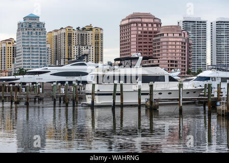 View from Palm Beach, Florida of yachts at the Palm Beach Town Docks with the downtown West Palm Beach skyline in the background. (USA) - Stock Photo