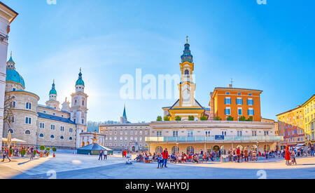 SALZBURG, AUSTRIA - FEBRUARY 27, 2019: Salzburg has its own charm, with its unique medieval houses, numerous bell towers, cozy outdoor cafes, so pleas - Stock Photo