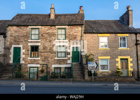 Alston green and yellow contrast neighbourhood. old brick houses - Stock Photo