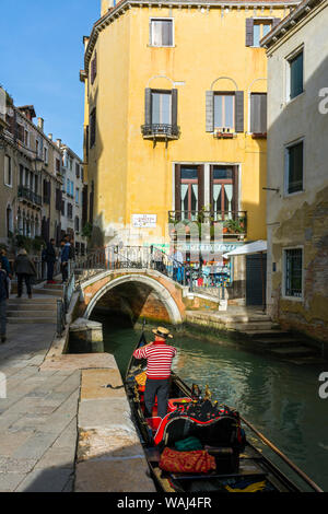 A gondola on the Rio del Megio canal at the Ponte del Megio bridge, from Calle Largo Rosa, Venice, Italy - Stock Photo
