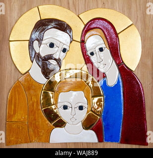 A glazed-tile mosaic of the Holy Family - Jesus, Mary and Joseph by Lubo Michalko. Displayed in the Quo Vadis Catholic House. - Stock Photo