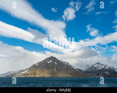 Royal Bay with typical dramatic clouds, South Georgia. - Stock Photo