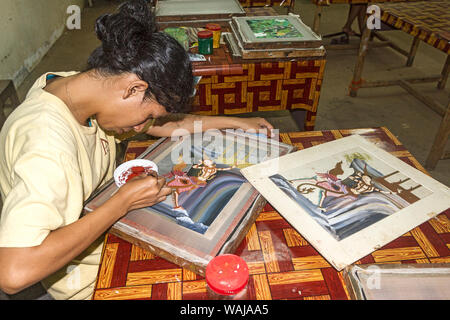 Siem Reap, Cambodia. Young deaf woman works on a silk painting at Artisans Angkor, a workshop that trains young uneducated and disabled Cambodian youths in craftwork. (Editorial Use Only) - Stock Photo