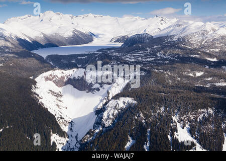 Aerial view of frozen Garibaldi Lake and lava barrier in the foreground. - Stock Photo