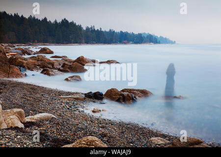 Long exposure of a ghostly image of woman on the beach in Sechelt, British Columbia, Canada - Stock Photo
