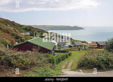 Holiday homes at the top of the cliffs at Tregonhawke, Whitsand Bay, Rame, Cornwall - Stock Photo