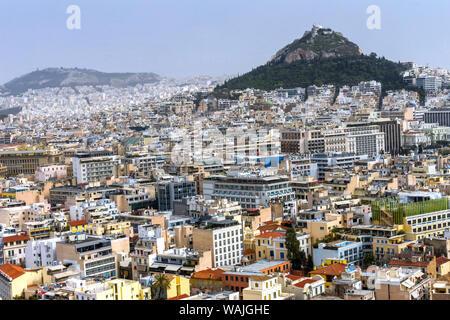 Neighborhoods from Acropolis Church Mount Lycabettus, Athens, Greece. Tallest mountain in Athens. - Stock Photo