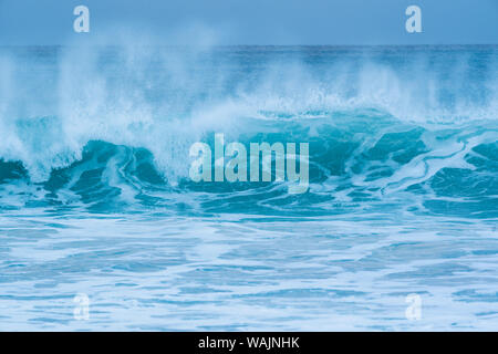 Norway, Lofoten Islands, Vestvag Island, Unstad. Waves along the coast near Unstad are popular for surfers even in winter. - Stock Photo