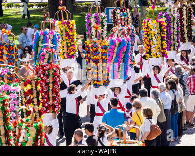 Portugal, Tomar. Girls carrying the Tabuleiros in the procession are decorated with symbols of the Holy Spirit - Stock Photo