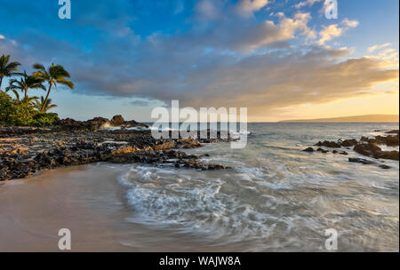 Evening light in small cove known as Secret Beach near Makena, Maui, Hawaii. - Stock Photo