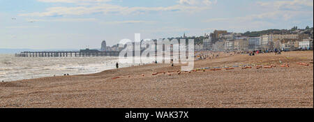 Beautiful panorama of Hasting Seafront with shingle beach and pier in background, Hastings, East Sussex, United Kingdom - Stock Photo