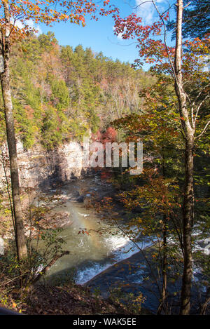 USA, Tennessee. view from suspension bridge over Cane Creek Cascades. Light refraction makes rainbow in mist - Stock Photo