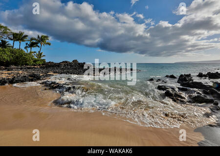 Evening light in small cove know as Secret Beach near Makena, Maui, Hawaii - Stock Photo