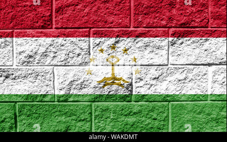 Flag of Tajikistan close up painted on a cracked wall - Stock Photo