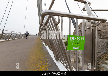 Samaritans poster, talk to us if things are getting to you on bridge footpath across M20 motorway, ashford, kent, uk - Stock Photo