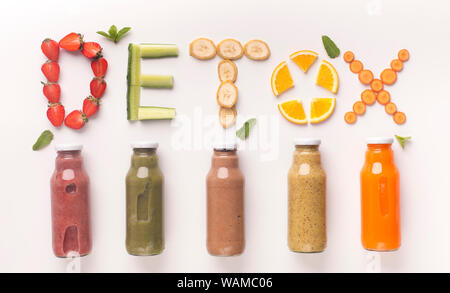 Colored healthy cocktails of fruits and vegetables in glass bottles - Stock Photo