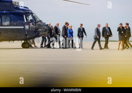 21 August 2019, Saxony, Schkeuditz: Angela Merkel, Federal Chancellor (CDU, M), and Peter Altmaier (CDU, l), Federal Minister for the Environment, are coming by helicopter to the first National Aviation Conference at Leipzig-Halle Airport. Guiding principle of the conference: The German aviation industry should become more competitive and at the same time more environmentally friendly. Among those expected are the Federal Chancellor, the Minister of Transport, the Minister of Economics and the CEO of Lufthansa. Discussions are also likely to take place about the air traffic tax. Photo: Jan Woi - Stock Photo