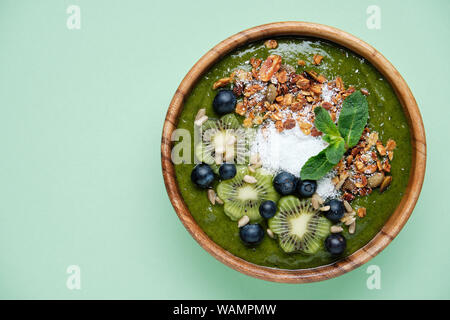 Smoothie bowls. Healthy breakfast bowl with chia seeds, muesli, berries, fruits and coconut flakes coconut flakes. Vegan food - Stock Photo