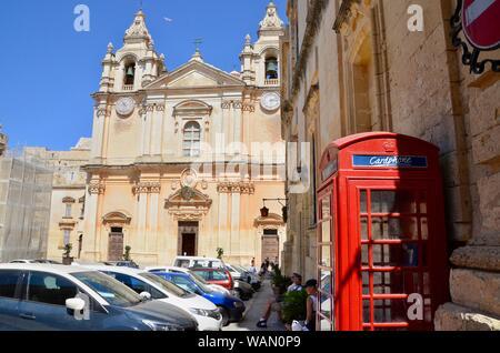 rabat/mdina red phone box near st pauls cathedral malta - Stock Photo