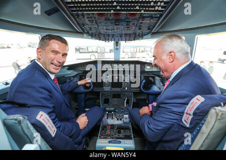 21 August 2019, Saxony, Schkeuditz: Martin Dulig, Economics Minister of Saxony (SPD, l), and Dave Jackson, Head of 328 Support Services, are sitting in a Dornier 328 at Leipzig-Halle Airport. The US-American company Sierra Nevada Corporation (SNC) plans to build the further development Dornier D328NEU as an aircraft with 39 seats in Leipzig in the future. Its predecessor, the Dornier 328 Turboprop propeller aircraft, was developed in the 1980s in Oberpfaffenhofen, Bavaria. It was the last airplane developed in Germany. At the end of 2023 the first plane is to go into service, the plane could a - Stock Photo