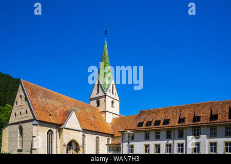 Germany, Ancient historic buildings and beautiful church spire of blaubeuren abbey in old town of blaubeuren town next to popular tourist destination - Stock Photo