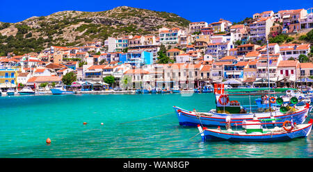 Beautiful Pythagorion village,view with traditional fishing boats,houses and sea,Samos island,Greece. - Stock Photo