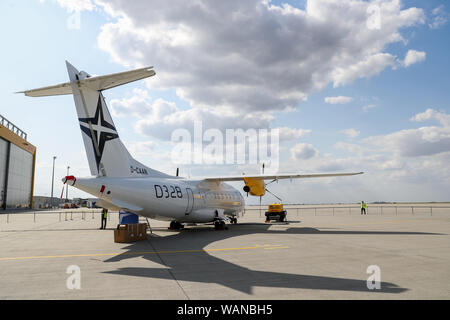 Schkeuditz, Germany. 21st Aug, 2019. A Dornier 328 is standing on the sidelines of the National Aviation Conference at Leipzig-Halle Airport. Credit: Jan Woitas/dpa-Zentralbild/dpa/Alamy Live News - Stock Photo