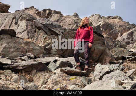 Mongolia Ulgii 2019-05-04 European scandinavian blonde girl in glasses with backpack do hiking, mountain climbing, walking, hiking. Freedom concept, t - Stock Photo