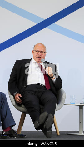 Schkeuditz, Germany. 21st Aug, 2019. Peter Altmaier (CDU, l), Federal Minister of Economics, speaks at the first National Aviation Conference at Leipzig-Halle Airport. Credit: Jan Woitas/dpa-Zentralbild/dpa/Alamy Live News - Stock Photo