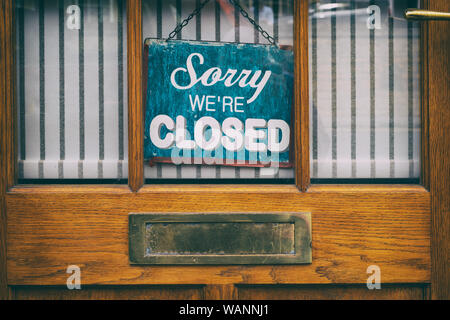 Sorry were closed sign on a shop wooden door. Stow on the wold, Gloucestershire, Cotswolds, England. Vintage filter applied - Stock Photo