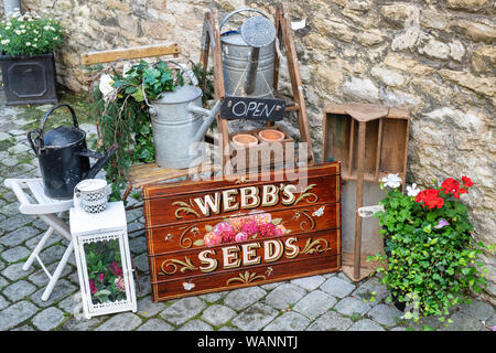 Vintage garden related items outside a shop in Stow on the wold, Cotswolds, Gloucestershire, England - Stock Photo