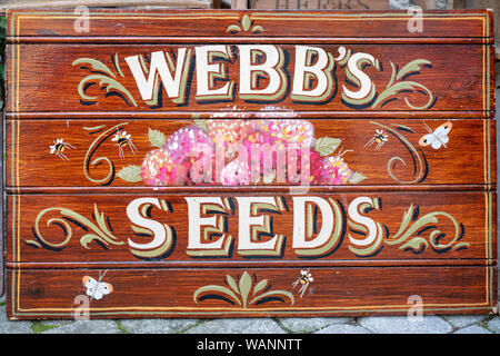 Vintage hand painted wooden seed sign outside a shop in Stow on the wold, Cotswolds, Gloucestershire, England - Stock Photo