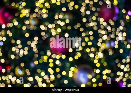 Blurred bokeh of Christmas light background. Close up decorations on Christmas celebration festival. - Stock Photo