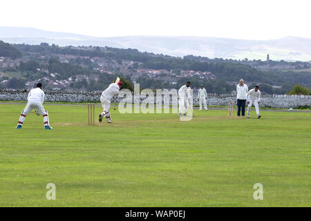 Village cricket match on a Saturday afternoon in Kirkheaton, West Yorkshire, England - Stock Photo