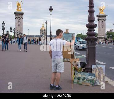 Painter in bridge in Paris, France - Stock Photo