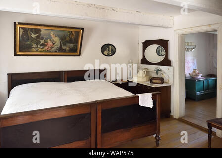 Osiek, Poland - August 16, 2019: Interior of old wooden house in The Folk Culture Museum in Osiek by the river Notec. - Stock Photo