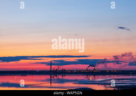 Dusk photo of Syncrude oil sands operations north of Fort McMurray, Alberta. - Stock Photo