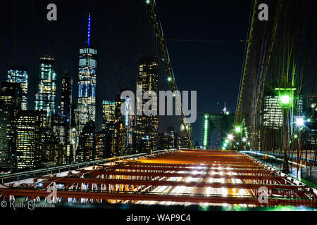 Long Exposure showing light trails of traffic leaving Manhattan into Brooklyn at night. Elevated view of workers leaving the busy city. - Stock Photo