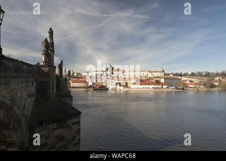Karluv most bridge, Vltava river, Mala Strana and Hradcany with Prazsky hrad castle in Praha city in Czech republic during nice early spring day - Stock Photo