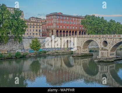Rome, Lazio, Italy - September 12, 2017: View of Ponte Sisto with reflections on the Tiber river at a sunset in Rome - Stock Photo